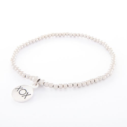 Our Sterling Silver Ball Bracelet with Kiss Hug Kiss Disc. Shown here, handcrafted with a stunning stamped XOX, 925 sterling Charm. In short, this beautiful piece is full of elegance, love, and kisses. It's the perfect self-indulgent purchase to add to your own jewelry collection. Or as the ultimate gift idea for someone very special.