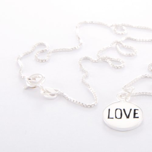 Our Sterling Silver Box Chain Necklace and Small Love disc. Shown here, handcrafted beautifully in 925 sterling. As well as with a small stamped charm. In short, this unique and elegant piece is sure to hit the mark. It's the ideal gift for someone special. Or as the perfect self-indulgent purchase to add to any jewelry collection.