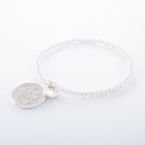 Our Sterling Silver Sixpence Ball Bracelet. Shown here, handcrafted and beautifully finished in 925 sterling with a stunning original coin. In short, this elegant and substantial piece is sure to hit the mark. It's the perfect gift idea for someone extra special. Or as the ideal self-indulgent purchase to add to your jewellery collection.