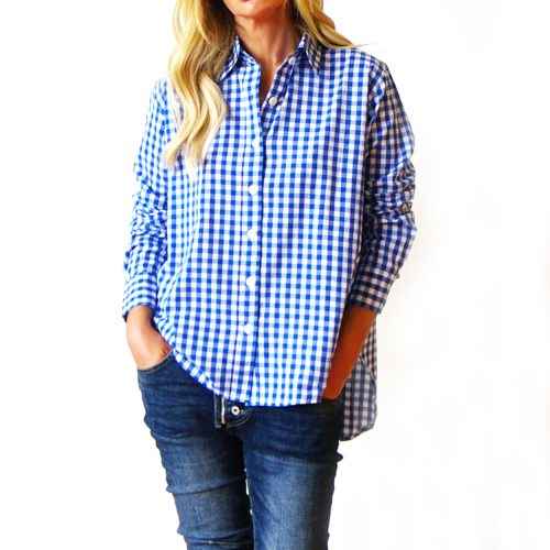 Our Riley Gingham Shirt (Blue and White). Shown here beautifully handcrafted in 100% pure cotton. With an easy button-up, front, relaxed wide collar, and medium-sized check. As well as a smart double button cuff and scooped hem at the back. Furthermore, Riley comes in 2 sizes. An S/M for ladies 8-10 and M/L for ladies 12-14. In short, it's the perfect self-indulgent purchase to add to your wardrobe. Or as the ideal gift for someone very special.