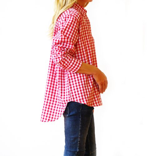 Our Riley Red and White Gingham Shirt (Side). Shown here with an easy button-up, front, relaxed wide collar, and medium-sized check. As well as a smart double button cuff and scooped hem at the back. Furthermore, Riley comes in 2 sizes. An S/M for ladies 8-10 and M/L for ladies 12-14. In short, it's the ideal self-indulgent purchase to add to your wardrobe. Or as the perfect gift for someone extra special.